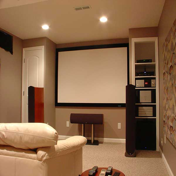 Mounted projector screen with custom shelving to the side