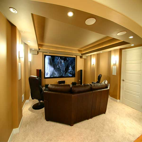 A home entertainment room with proper speakers, lighting, etc.