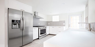Brand new kitchen with stylish countertops and new appliances