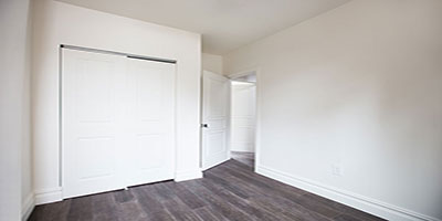 Additional bedroom with new closets and hardwood floor